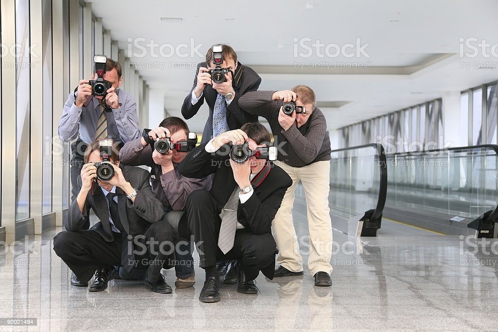 Group of paparazzi posed and ready to capture the moment stock photo