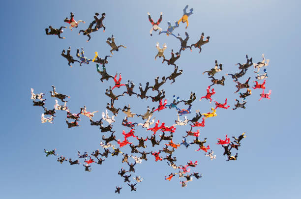 A group of parachutists jumping from parachute on March 27, 2012 in Eloy Arizona, USA stock photo