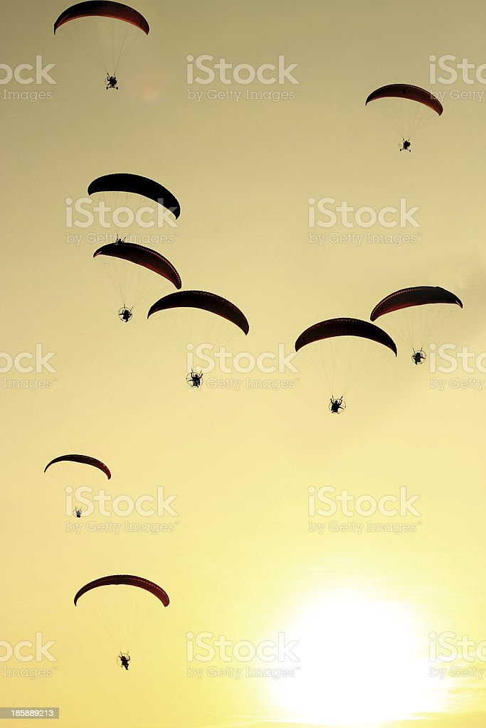 Group of paragliding on the sunset background royalty-free stock photo