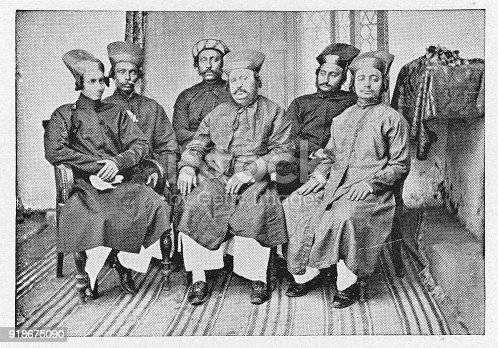 Group of Parsi men in Bombay, India during the british era. Vintage halftone circa late 19th century. Bombay is now modern day Mumbai.