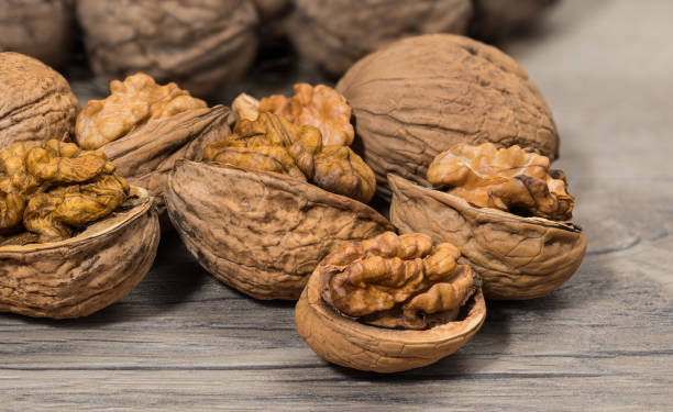 Group of partly peeled nuts with half shells closeup stock photo