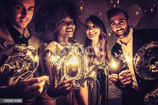 istock Group of party people celebrating the arrival of 2019 1055924080