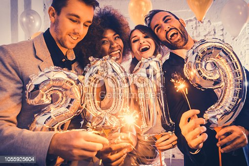 istock Group of party people celebrating the arrival of 2019 1055925604