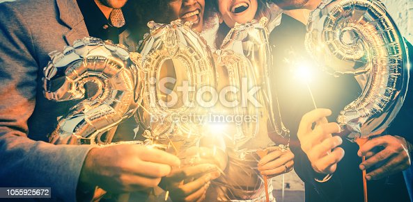 istock Group of party people celebrating the arrival of 2019 1055925672