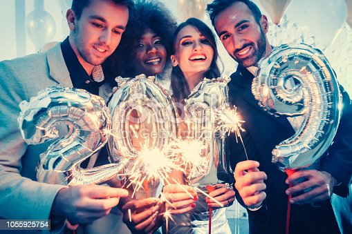 istock Group of party people celebrating the arrival of 2019 1055925754