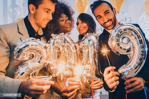 istock Group of party people celebrating the arrival of 2019 1055925812