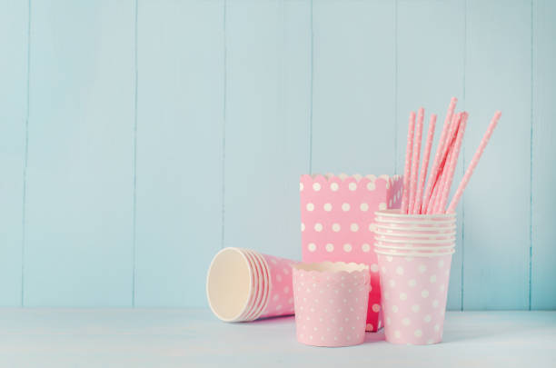 Group of party supplies on blue wooden table stock photo