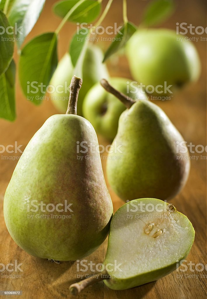 Group of pears sitting on table stock photo