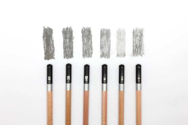 Group of pencils samples with different types of graphite, 8B, 3B, HB, H, 4H, F. stock photo