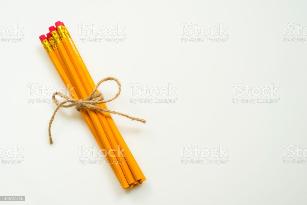 Group of pencils tied with rope isolated on white background stock photo