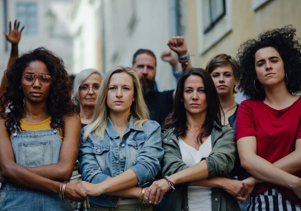 Group of people activists protesting on streets, women march and demonstration concept. stock photo