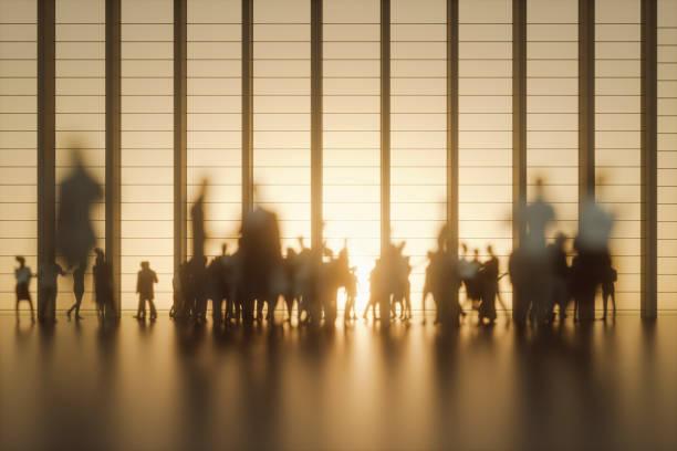 group of people against modern glass facade - persona in secondo piano foto e immagini stock