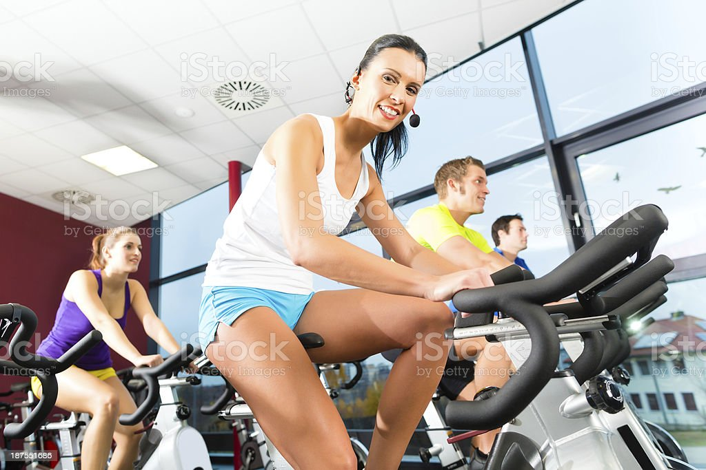 Group of people and instructor in gym stretching royalty-free stock photo