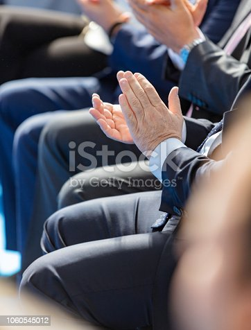 511305456 istock photo Group of people applauding 1060545012