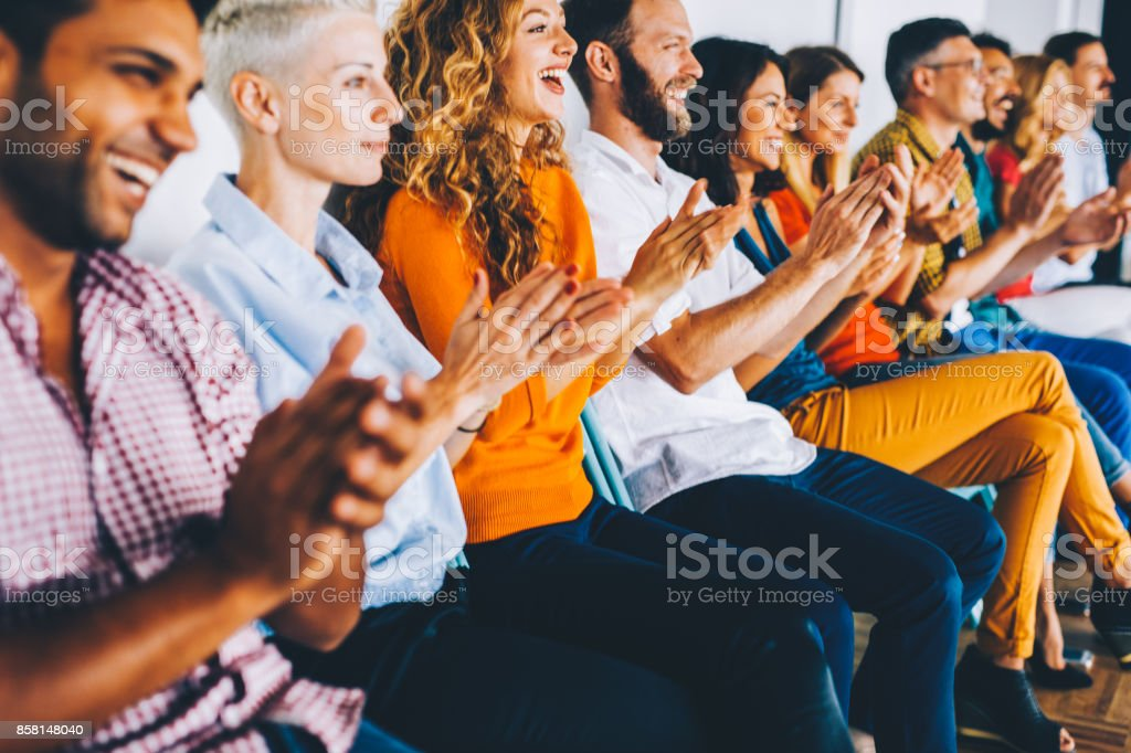 Group of people applauding stock photo
