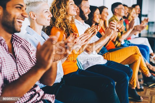 858148040 istock photo Group of people applauding 869880274