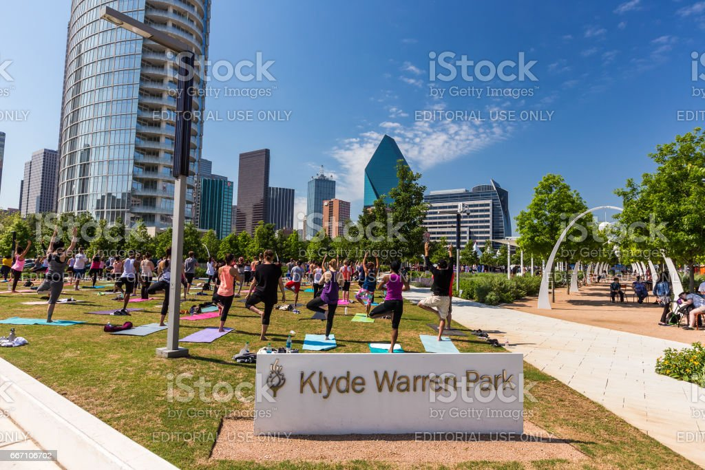 Group of people are doing yoga in Klyde Warren Park in downtown Dallas stock photo