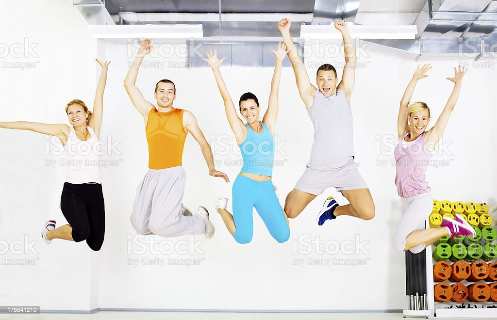 Group of people are jumping in the gym. royalty-free stock photo
