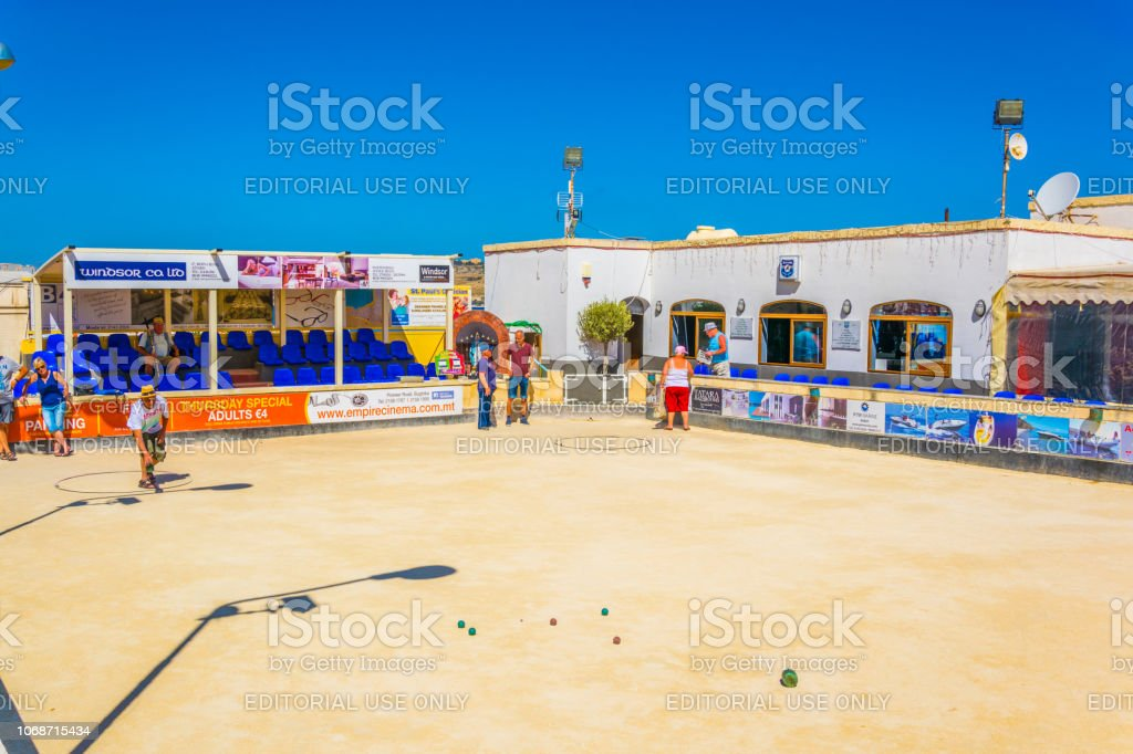 A group of people are playing petanque in Bugibba, Malta stock photo