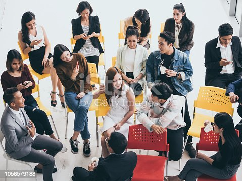 istock Group of people are talking together while taking a coffee break from seminar 1056579188