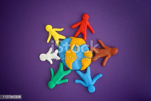 Group of people around the world. Concept image. People and Earth are made out of play clay (plasticine). Close up.