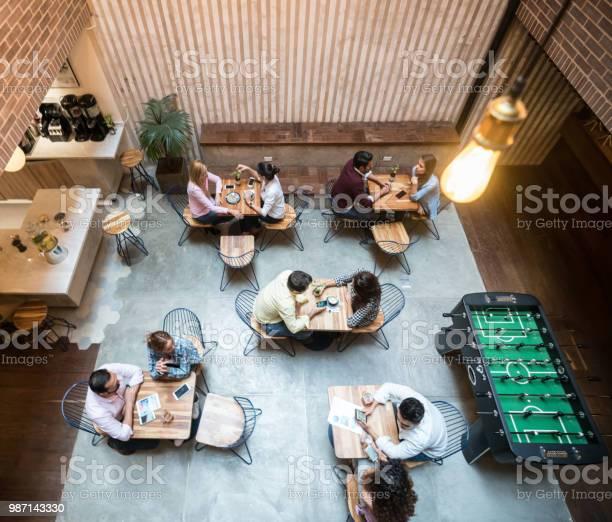 Group of people at a cafe picture id987143330?b=1&k=6&m=987143330&s=612x612&h=md1glfc9s1lpdyyhsjgei6sjg yrbjtzqnyri82tp k=