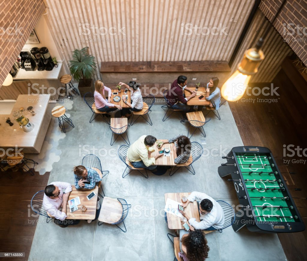 Group of people at a cafe stock photo