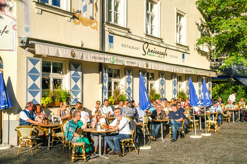 Group of people at a sidewalk cafe, Munich, Bavaria, Germany