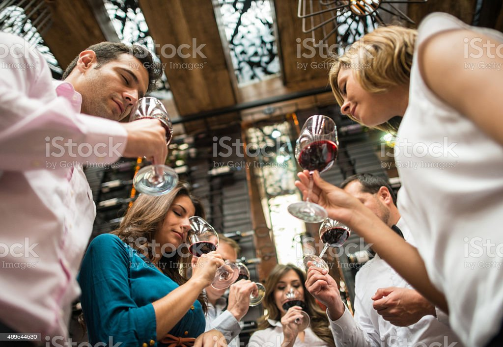 Group of people at a wine taste stock photo