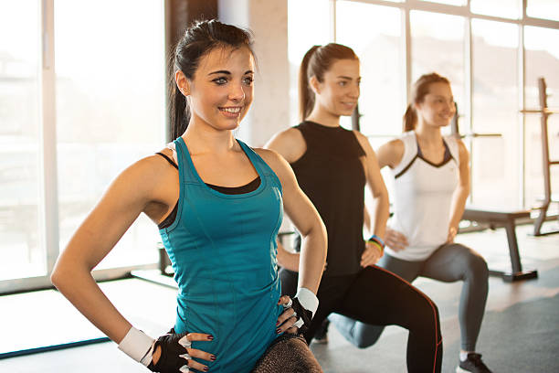 Group of people at the gym in a stretching class. stock photo