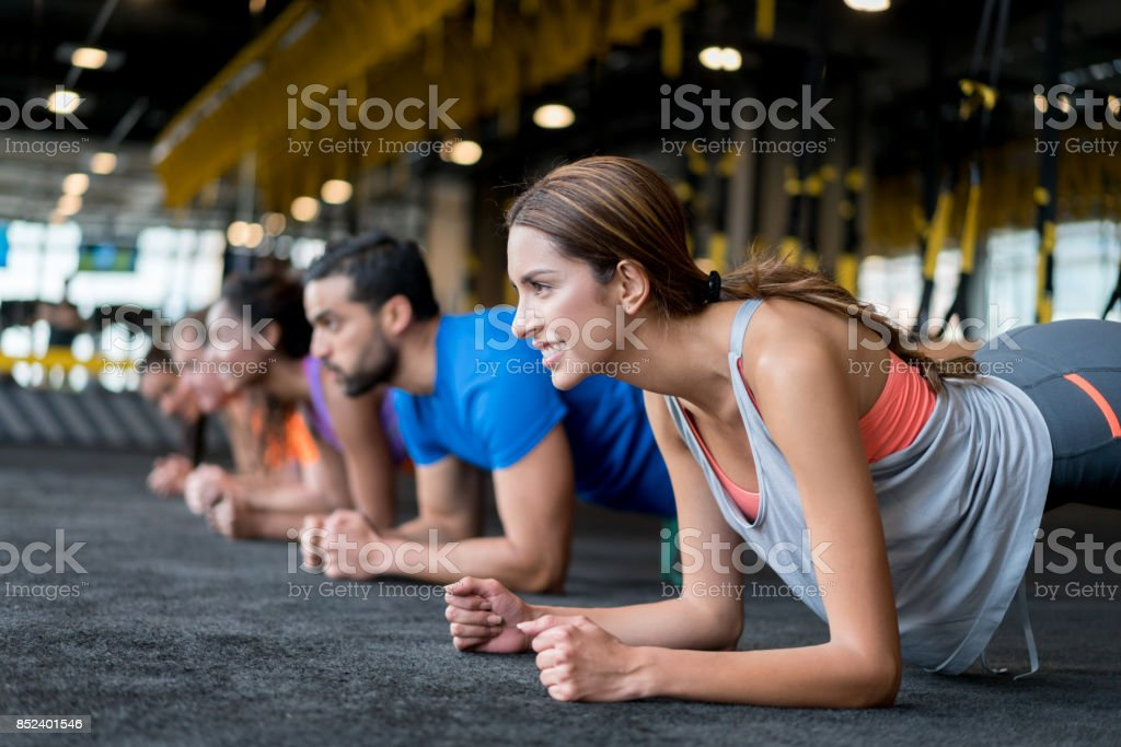 Group of people at the gym in a suspension training class stock photo