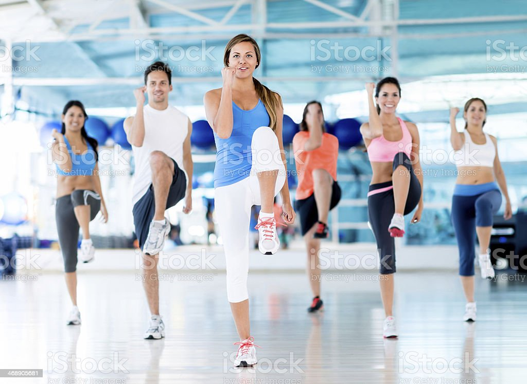 Group of people at the gym stock photo