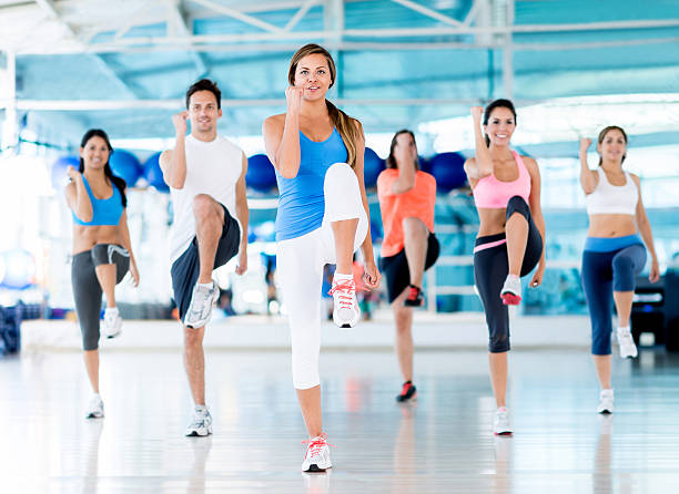 group of people at the gym - aerobics stock photos and pictures