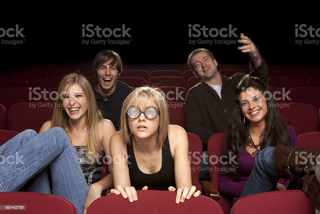 Group of people at the movies, Female can't see it - Stock image .