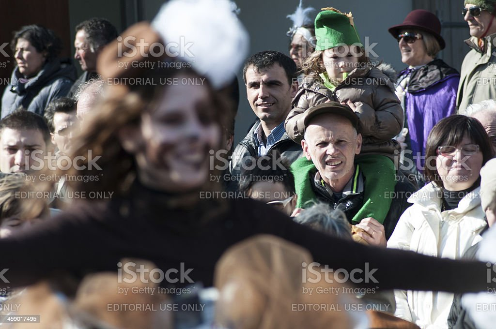 Group of people attending the carnival parade in Muggia,Italy royalty-free stock photo