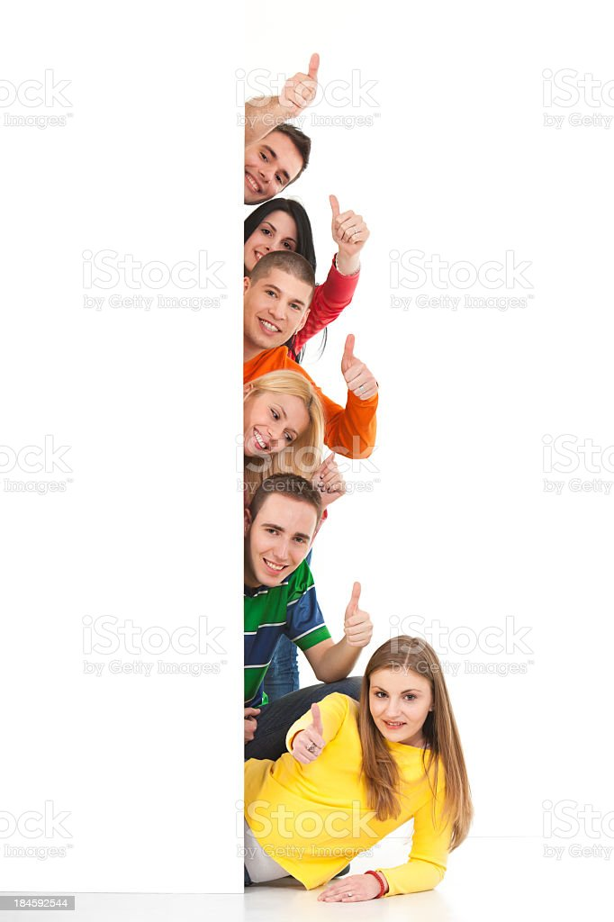 Group Of People Behind Banner Showing Thumbs-up stock photo