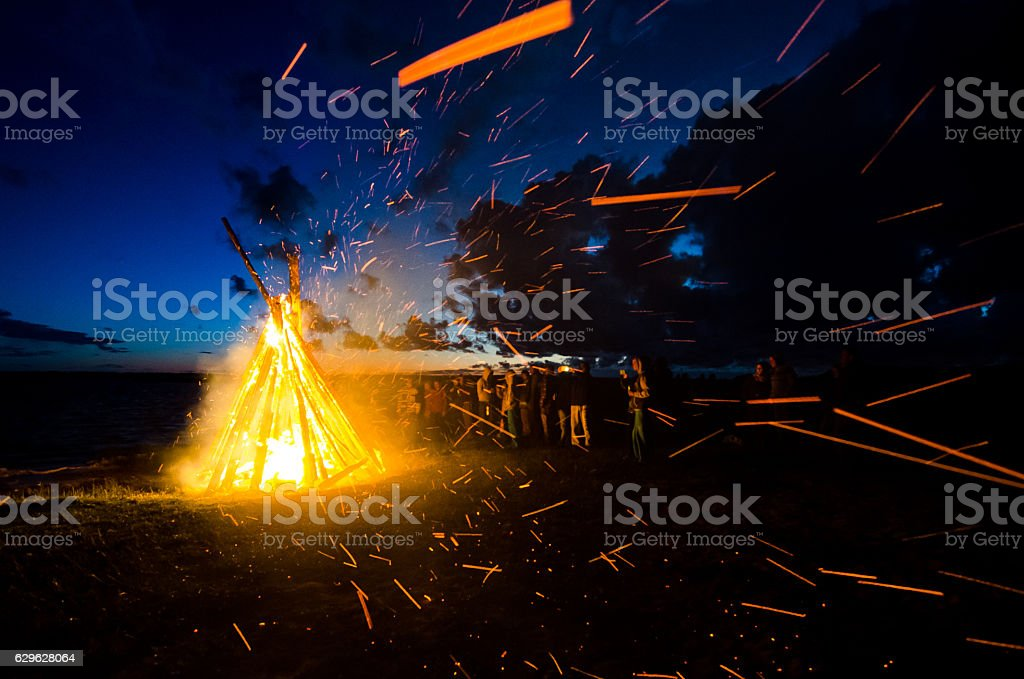 Group of people celebrating June solstice at the bonfire stok fotoğrafı