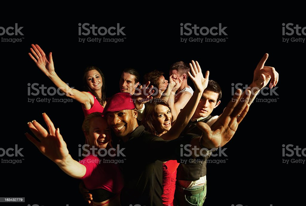 Group of people cheering on black background royalty-free stock photo