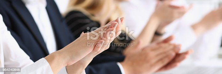 istock Group of people clap their arm in row during 954240848