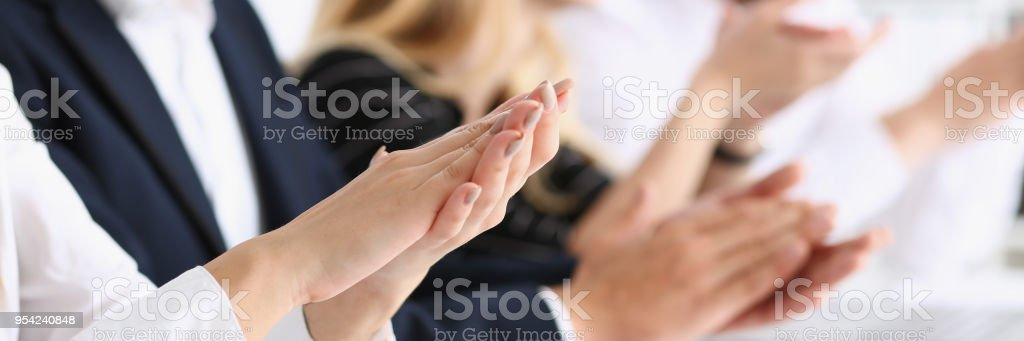 Group of people clap their arm in row during stock photo