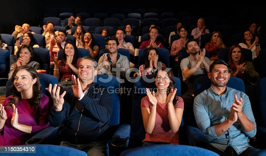 istock Group of people clapping at the theater 1150354310