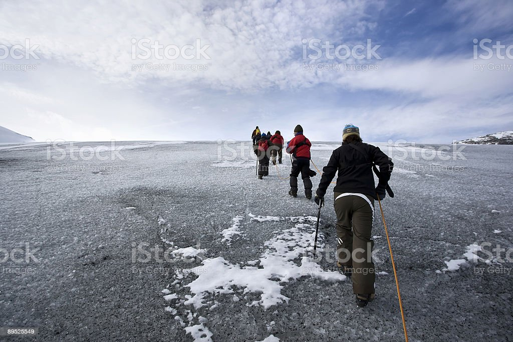 Group of people climbing glacier royalty-free stock photo