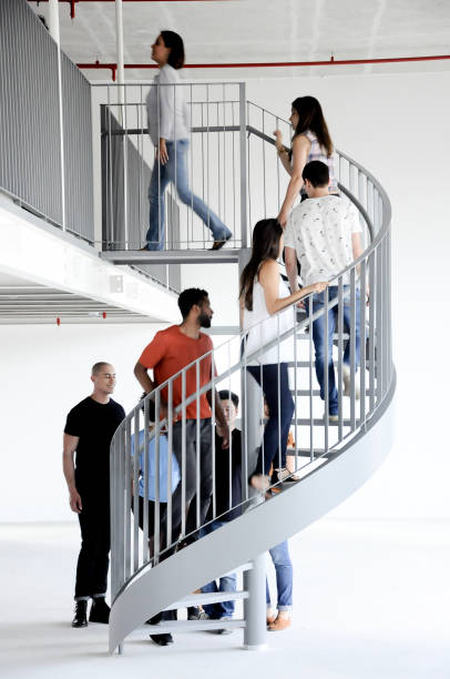 Group of people clubbing stairs stock photo