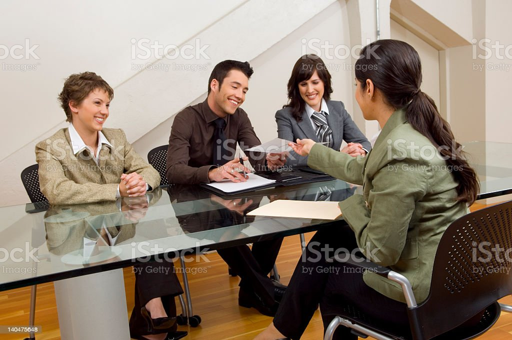 Group of people conducting an interview over a desk royalty-free stock photo
