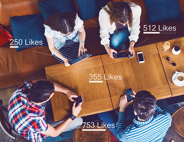 Group of people counting likes stock photo
