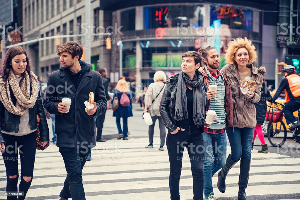 Group of people crossing the street in New York. stock photo