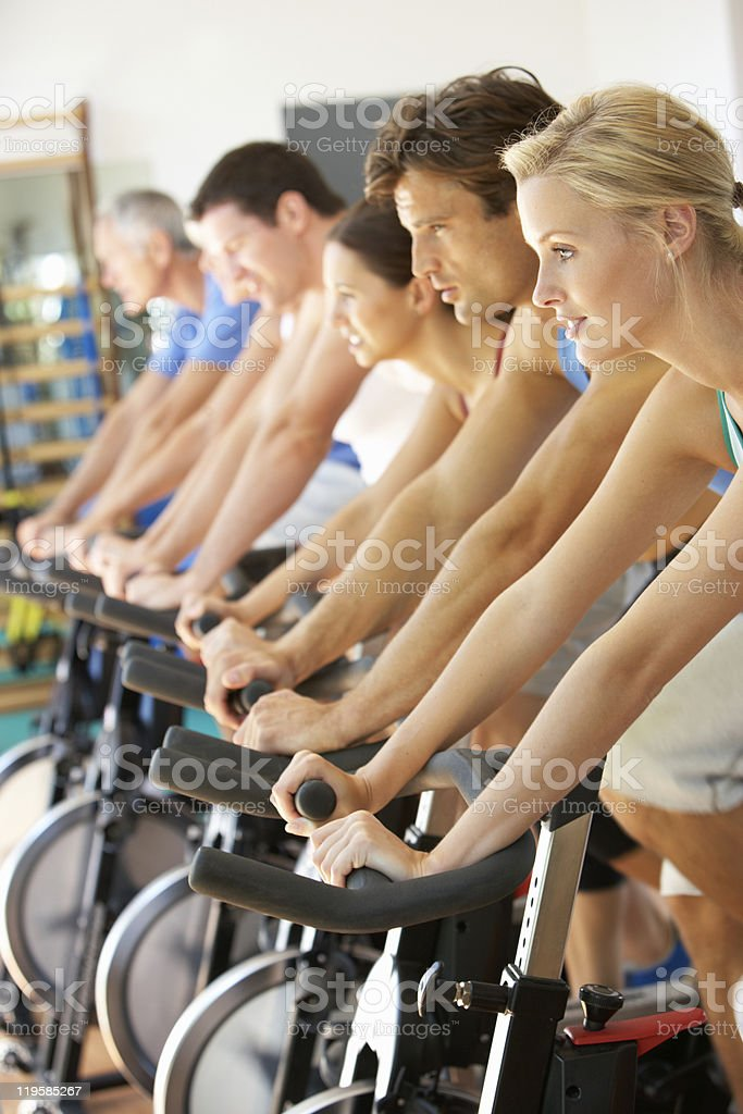 Group of People Cycling In Spinning Class stock photo