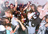 Top view of joyful young group of people dancing in a bar or nightclub at a party