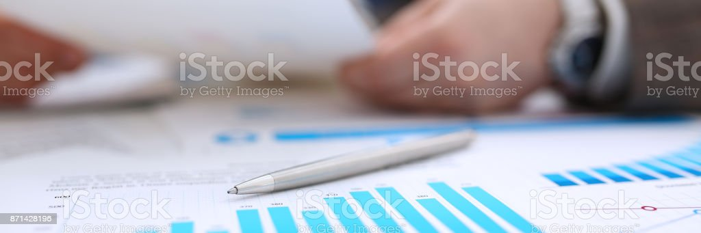 Group of people deliberate on problem with infographics closeup - foto stock