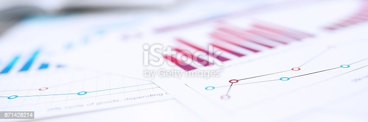 istock Group of people deliberate on problem with infographics closeup 871428214